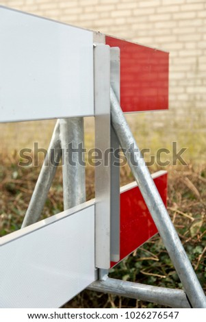 Construction work: a red and white barrier fence