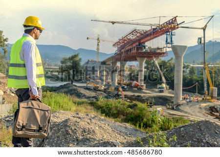 Construction work and business plan with one worker preparing for work with bag and his project plan of bridge