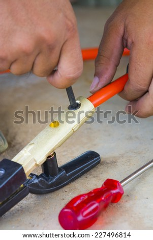 construction worker and Welding electrode holder - stock photo