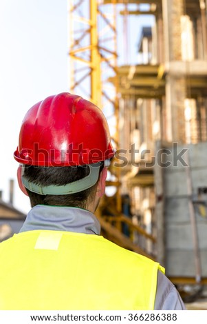 Construction worker at new buildings - stock photo