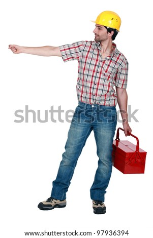 Construction worker carrying a toolbox, studio shot - stock photo