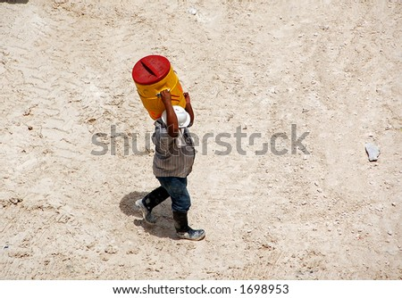 Construction worker carrying water - stock photo
