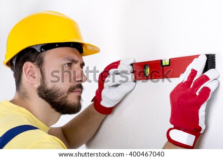 construction worker check the level on the wall - stock photo