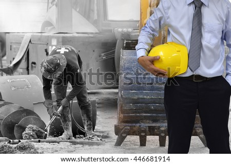 Construction worker concept . engineer  holding helmet and construction background