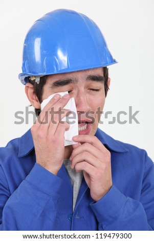 Construction worker crying