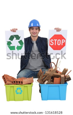 Construction worker encouraging people to recycle waste - stock photo
