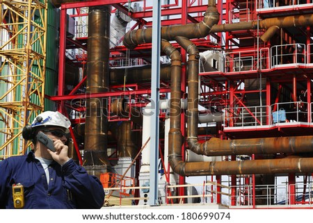 construction worker, engineer in front of large building site - stock photo