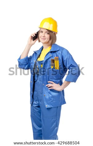 construction worker, engineer or architect female in yellow hardhat and blue workwear with mobile phone isolated on white background
