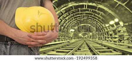 Construction worker hands holding yellow plastic helmet isolated on white background   keep hard hat close-up  - stock photo