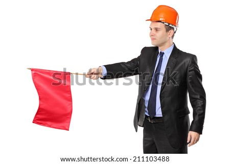 Construction worker holding a red flag isolated on white background - stock photo