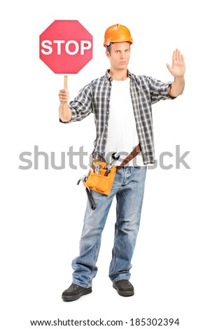 Construction worker holding a stop sign isolated on white background - stock photo