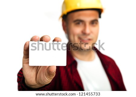 Construction worker holding blank business card, business introduction concept.
