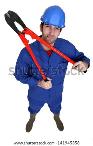 Construction worker holding large pliers
