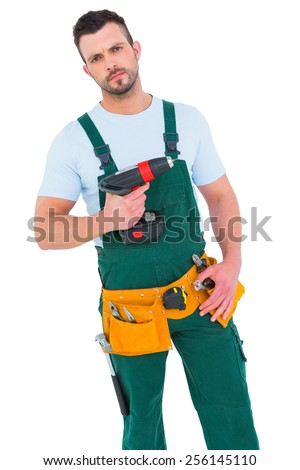 Construction worker holding power drill on white background - stock photo