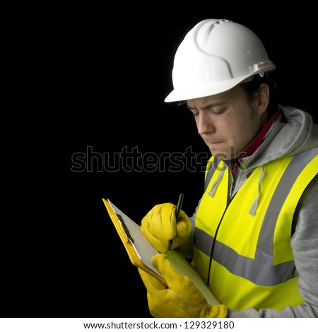 construction worker in helmet, high visability vest and gloves, writing on clipboard - stock photo