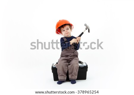 Construction worker in orange helmet with hammer sitting on tools box - stock photo