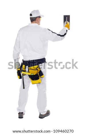 construction worker in white coveralls wall putty trowel hammer - stock photo