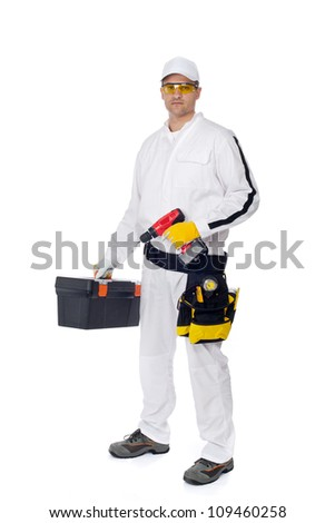 construction worker in white coveralls with a tool box screw driver - stock photo