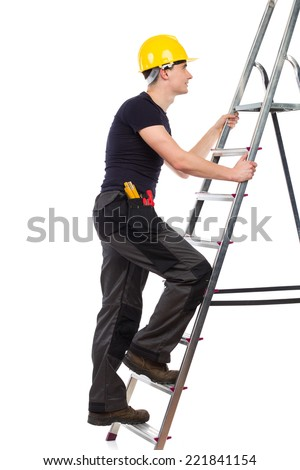 Construction worker in yellow helmet climbing a ladder. Side view. Full length studio shot isolated on white. - stock photo
