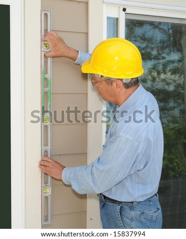 Construction worker installing new windows