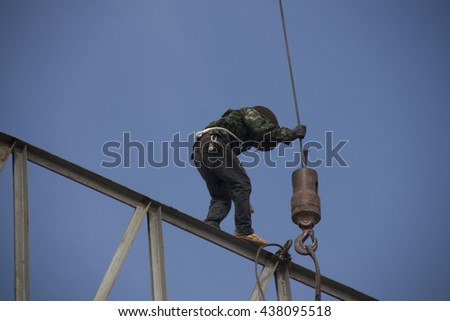 construction worker is working not safety on steel roof truss in construction site,construction worker is high place dangerous work,Do not work on the dangerous work,construction worker is careless