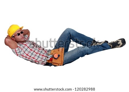 Construction worker lazing about - stock photo