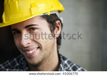 Construction worker looking at camera. Copy space - stock photo