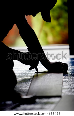 Construction worker measuring during a remodel and/or floor installation. - stock photo
