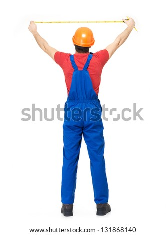 Construction worker measuring the wall over white background -  manual worker full portrait  rear view - stock photo