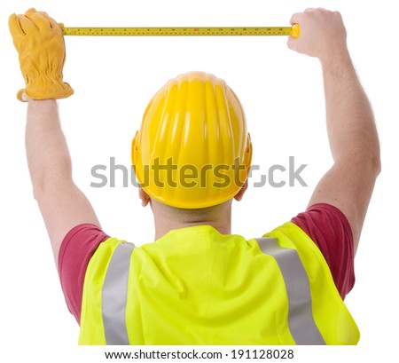 construction worker measuring with tape isolated on a white background - stock photo