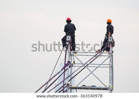 construction worker on a scaffold, symbolfoto for building, construction boom, labor protection - stock photo