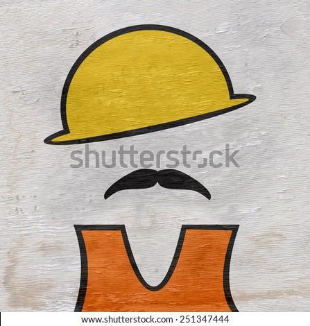construction worker on wood grain texture - stock photo