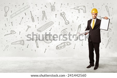 Construction worker planing with hand drawn tool icons on background - stock photo