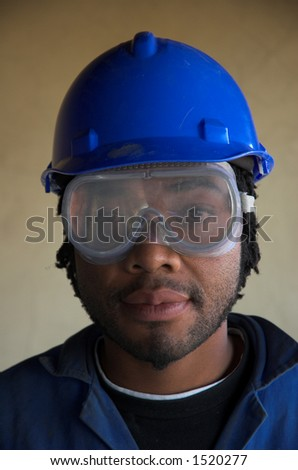 Construction worker plumber with safety goggles mask over eyes