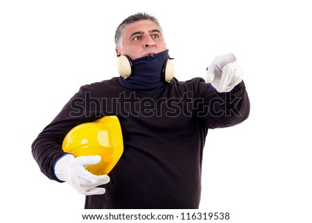 construction worker pointing ahead looking at something - stock photo
