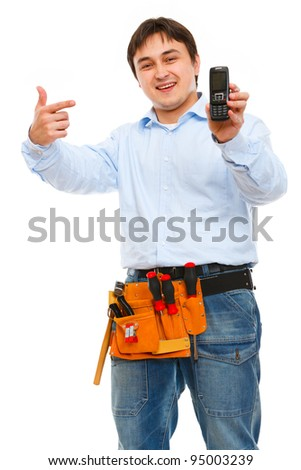 Construction worker pointing on mobile - stock photo