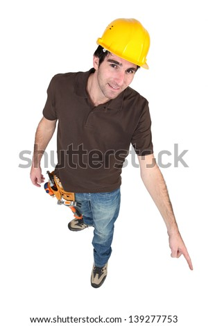Construction worker pointing to the floor