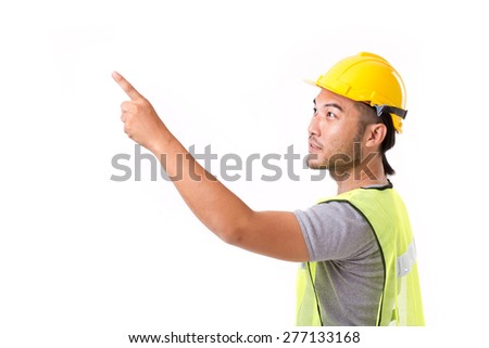 construction worker pointing up at blank space - stock photo