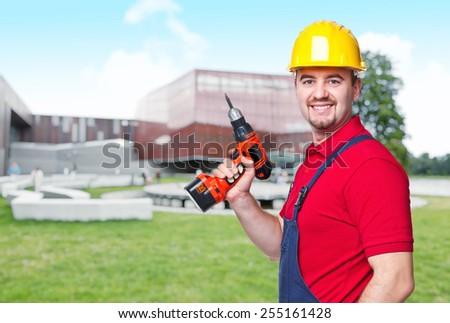 construction worker portait and building background - stock photo