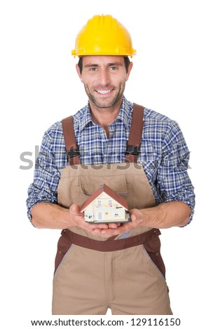 Construction worker presenting house model. Isolated on white - stock photo