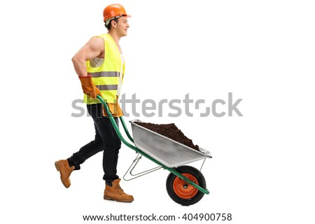 Construction worker pushing a wheelbarrow with a pile of dirt in it isolated on white background - stock photo