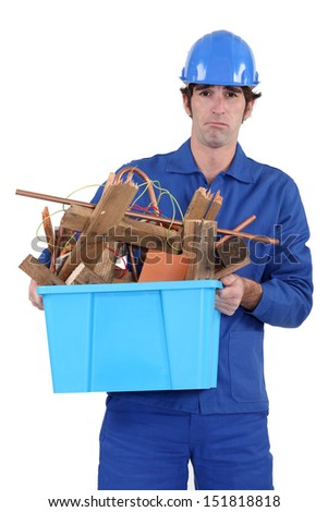Construction worker recycling old wood - stock photo