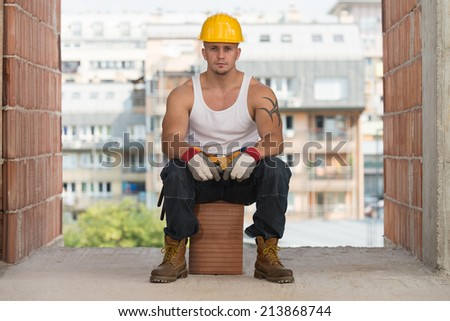 Construction Worker Relaxing The Fresh Air During Work - stock photo