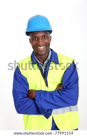 Construction worker standing on white background - stock photo