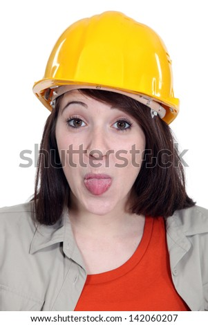 Construction worker sticking her tongue out