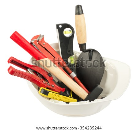 Construction worker supplies including  white hard hat on isolated white background - stock photo