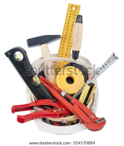 Construction worker supplies including  white hard hat on isolated white background, top view - stock photo