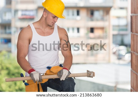 Construction Worker Taking A Break On The Job - Construction Worker Relaxing The Fresh Air During Work - stock photo