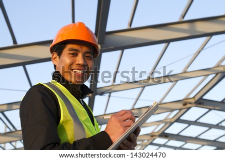 Construction worker under new building - stock photo