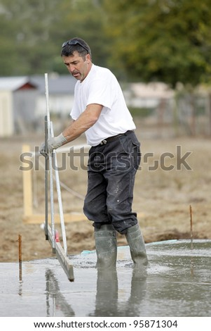 Construction worker using a technical tool - stock photo